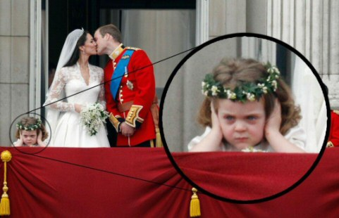 Little girl looking board at William and kate's wedding on the royal balcony