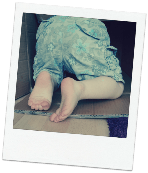 Image of child crawling into a large box