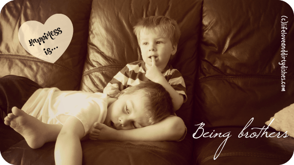 Image of two boys together on the sofa chilling out
