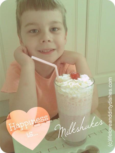 Image of boy with a strawberry milkshake