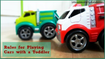 Image of two toy cars on the floor with the text rules for playing cars with a toddler