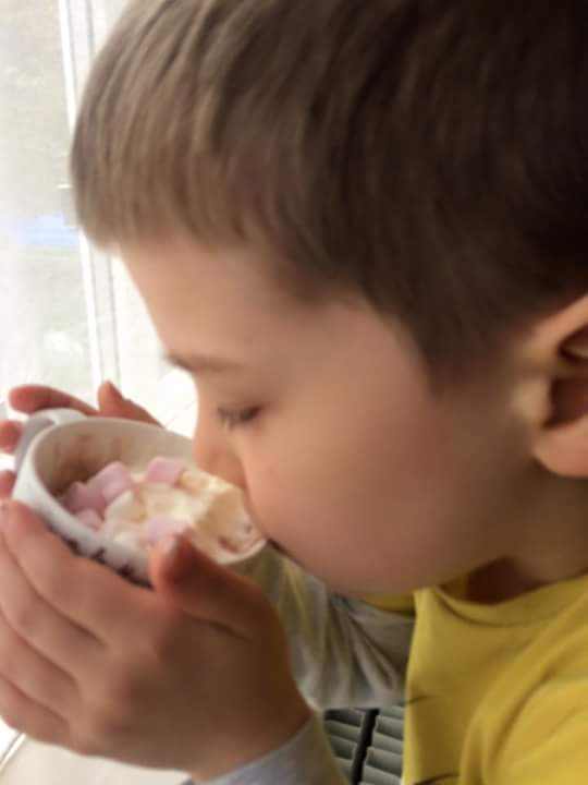 child drinking hot chocolate