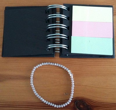 Note pad and bracelet brought as part of this months five under £5