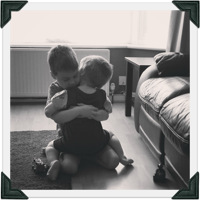 Image of two boys hugging each other and meaning everything to each other