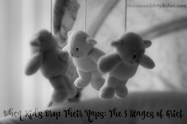 Image of a cot mobile with the text When Kids Drop Their Naps: The 5 Stages of Grief