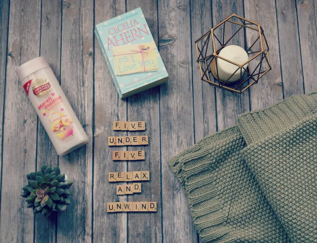Relax and unwind five under five flatlay image of products