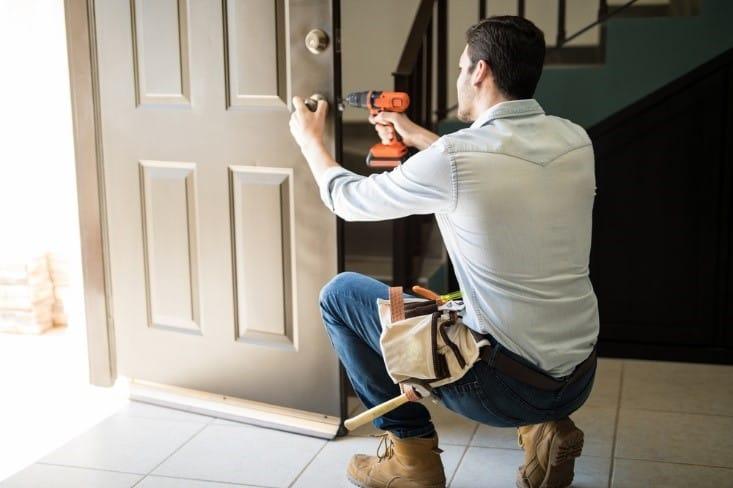 Image of handyman fixing a door
