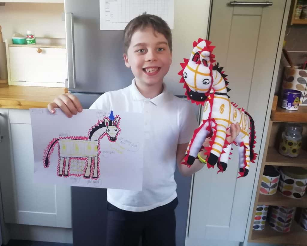 Petplan Equine. Image of boy with toy horse and drawing of toy horse